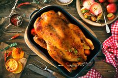 Roast Christmas duck with thyme and apples stock photo