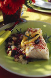 Roast cod with olives and confit citrus Royalty Free Stock Photography