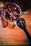 Roast coffee bean in glass shot on wood table use coffee topic and related Stock Photo
