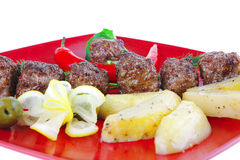 Roast cutlets on red dish Royalty Free Stock Images