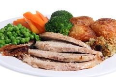Roast Dinner. Roast pork dinner with roast potatoes, stuffing and vegetables Royalty Free Stock Photos
