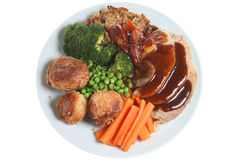 Roast Dinner. Traditional Sunday roast pork dinner with all the trimming Stock Photography