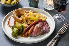 Roast dinner with beef. Traditional roast dinner with beef, carrots, brussel sprouts and gravy royalty free stock image