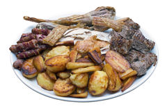 Roast Dinner Serving Platter. With turkey, roast potatoes, parsnips, sausages, stuffing and crackling on an isolated white background with a clipping path Stock Photo