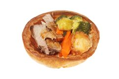 Roast dinner in a Yorkshire pudding. Roast beef dinner in a giant Yorkshire pudding isolated against white Stock Images