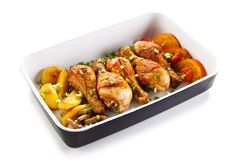 Roast drumsticks with potatoes and champignon. Roast drumsticks with potatoes and mushrooms stock photo