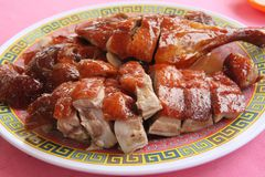 Roast duck. Chinese cuisine sliced portions on plate royalty free stock image