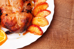 Roast duck with apples and oranges Royalty Free Stock Images