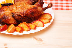 Roast duck with apples and oranges Stock Photo