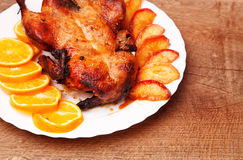 Roast duck with apples and oranges Stock Images