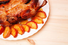 Roast duck with apples and oranges Royalty Free Stock Photo