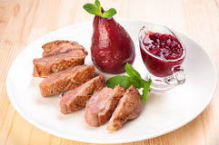 Roast duck breast with raspberry sauce Royalty Free Stock Photos