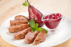 Roast duck breast with raspberry sauce Royalty Free Stock Photography