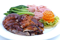 Roast duck, chinese style. A plate of chinese style roast duck with vegetable isolated Stock Photo
