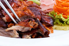 Roast duck, chinese style. A plate of chinese style roast duck with chopstick Royalty Free Stock Image