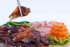 Roast duck, chinese style. A plate of chinese style roast duck with chopstick Royalty Free Stock Images