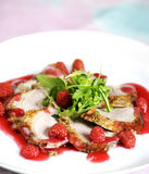 Roast duck fillet with raspberry. One of the best meal is a duck. In Poland is eating for special time, for example New Year, or Easter. Raspberry from forest Stock Images