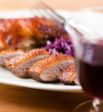 Roast duck and a glass of red wine Stock Photo