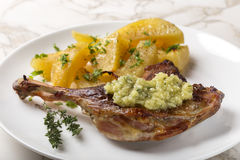 Roast duck with golden potatoes and garlic sauce with herbs Stock Photo