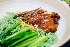 Roast duck with green noodle soup Stock Photo