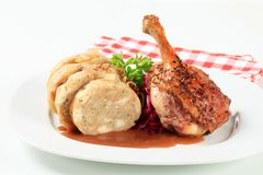 Roast duck leg with bread dumplings and red cabbage Royalty Free Stock Photo