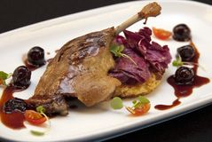 Roast Duck Leg with cherries Stock Photo