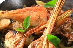 Roast duck leg with onion Stock Photo