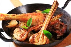 Roast duck leg with onion Royalty Free Stock Photography