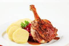 Roast duck leg with potato dumplings and red cabbage Royalty Free Stock Images
