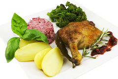 Roast Duck leg with potato, green leaves, beet salat, sprouting broc Royalty Free Stock Photos