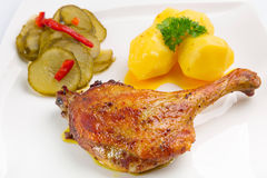 Roast duck leg with potatoes Stock Images