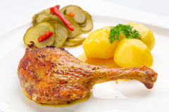 Roast duck leg with potatoes royalty free stock images