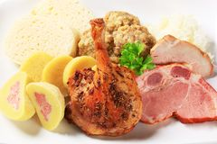 Roast duck leg and smoked pork with dumplings Stock Images