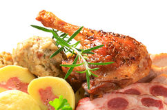 Roast duck leg and smoked pork with dumplings Royalty Free Stock Photos