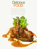 Roast duck legs served with mashed potatoes. Stock Photo