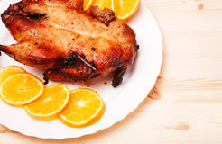 Roast duck with oranges. For christmas holidays Royalty Free Stock Photo