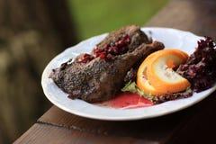 Roast duck with pomegranate gravy Stock Photo