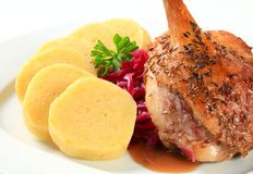 Roast duck with potato dumplings and red cabbage Stock Image