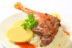 Roast duck with potato dumplings and sauerkraut Royalty Free Stock Photography