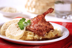 Roast duck with sauerkraut and dumplings Stock Photos