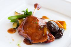 Roast duck thigh with sweet fruit sauce. Stock Photo