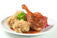 Roast duck with Tyrolean dumplings and red cabbage Royalty Free Stock Photos