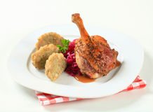 Roast duck with Tyrolean dumplings and red cabbage Stock Photos