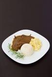 Roast eye of round with roti sauce dish Stock Photos