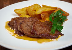 Roast fillet beef with potatoes. Shallow depth-of-field stock images
