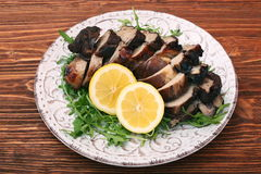 Roast fillet leg of lamb with greens and lemon Royalty Free Stock Images