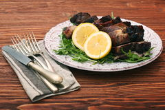 Roast fillet leg of lamb with greens and lemon Royalty Free Stock Photos