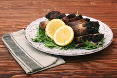 Roast fillet leg of lamb with greens and lemon Royalty Free Stock Photo