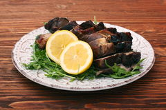 Roast fillet leg of lamb with greens and lemon Royalty Free Stock Photography