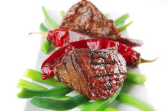 Roast fillet mignon with peppers Royalty Free Stock Photography